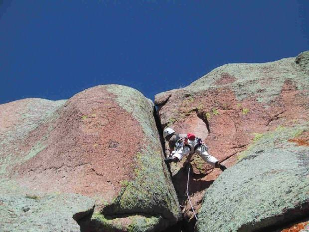 Kreighton Bieger just below the crux on the first pitch of Quits.