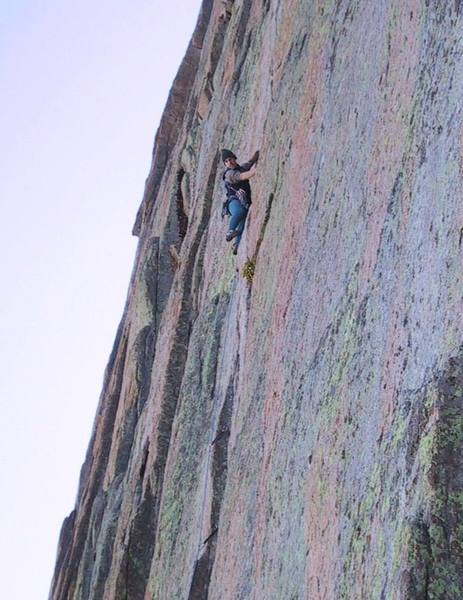 George Squibb on the 5.11c/d crux of D7 on the Diamond.
