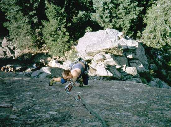 Joseffa Meir makes the crux of East Crack (Cob Rock) go technical with Body English and foot placement. Photo by Tony Bubb, Circa 2001.
