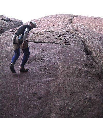 Mark Oveson rapping off ye old historic bolt (backed up to another rope above).  Crescent Crack is the big crack to the right.