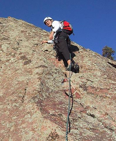 Warren Teissier on the second pitch of Enchanted Devil, Flatirons Central.