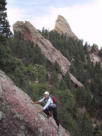 Warren Teissier negotiating one of the many ridge gaps on Jaws.  [That is the Sunset Flatironette on the left and the First Flatiron to the right. The top of the Second Flatiron is out of the photo to the right.]<br> <br> Photo by George Bell