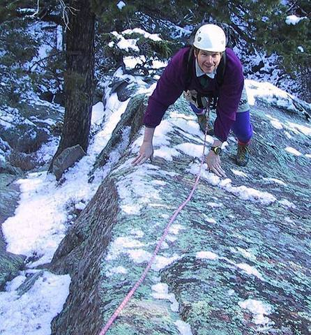 """Here is a higher quality version of the same photo as above.  Kids, don't try this at home!  Mark Oveson climbs """"Lichen Wars""""."""
