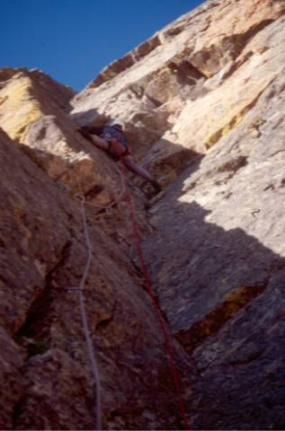 Carol leading the 2nd pitch corner on Better than Love, Hallett Peak.