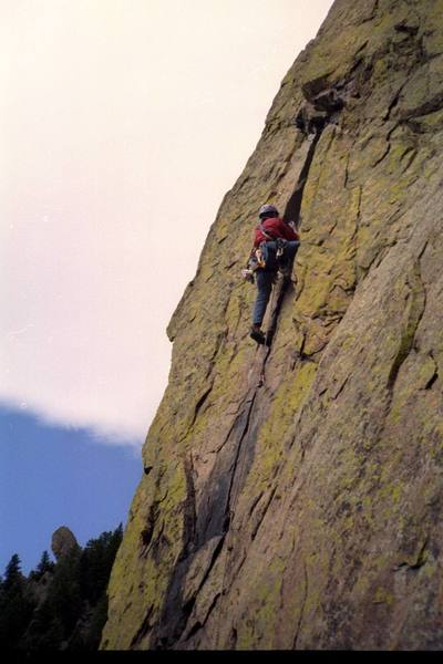 Monte Lewis of New Richmond, WI, above the traverse on the 4th pitch.  Photo by Kevin Currigan 10/20/01.