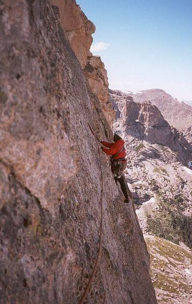 Joseffa Meir leading the airy 5.7 traverse pitch of Sykes Sickle on the Spearhead (RMNP).<br> <br> Photo by Tony Bubb.