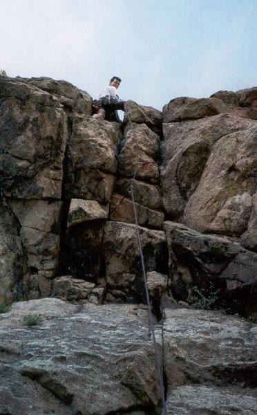 Mark Speiker Leads the crux roof of West Overhang on Eldo's Wind Tower.  Photo by Tony Bubb.