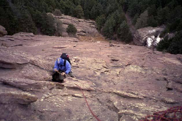 Roger Wilkerson about 400' up.  No waiting when its 40 degrees out.  Photo by Kevin Currigan.  Dec. 9, 2001.