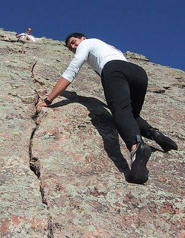 Warren Teissier on the upper crack.  Note that the best holds are often not in the crack.