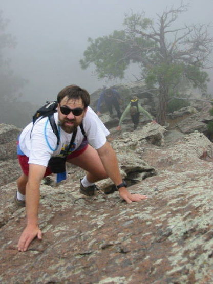 George Bell, Kreighton Bieger, and Warren Teissier just above the crux on a foggy morning.
