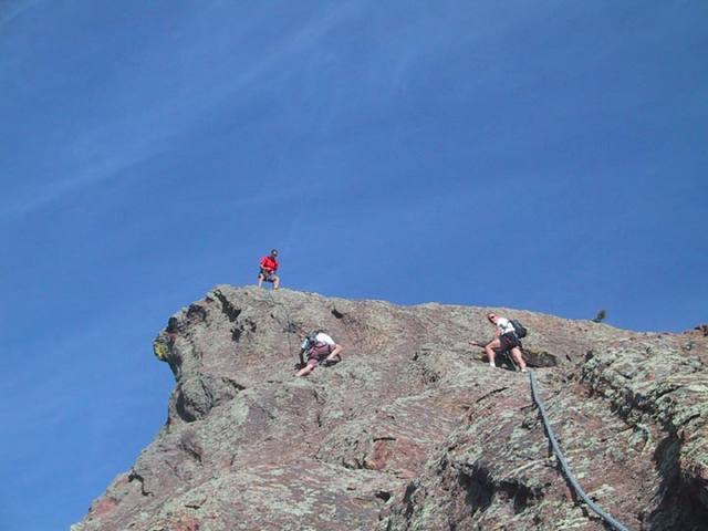 Bill does a cool hip belay on the summit of the Fifth. Scott and Bernard are nearing the summit.