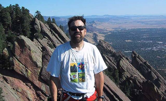 George Bell on the summit of the Fist.  Visible behind are the first four Flatirons and the top of Schmoe's Nose.