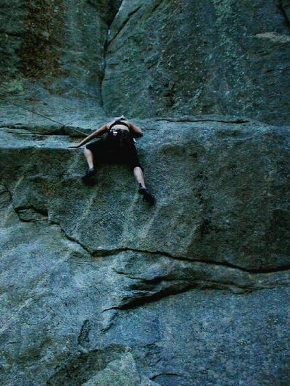 Kate mantling the crux on the first pitch of Athlete's Feat