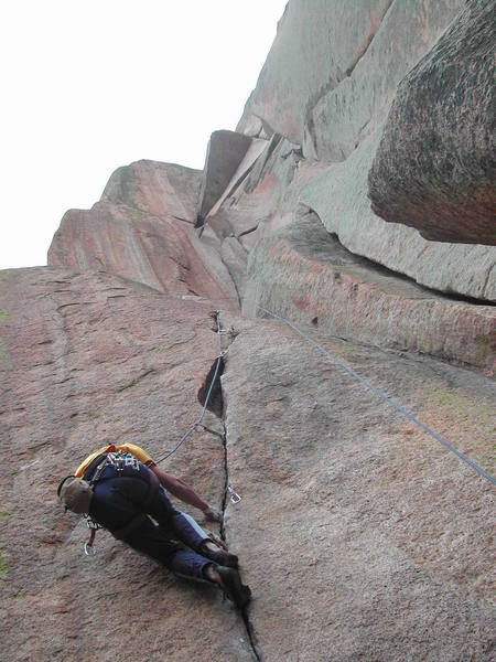 Cleaning the Breashears start after leading it on one rest.  Rest of the striking route is shown above - I believe the wide crack shown in the right side of the photo is the 5.10 start for the route.