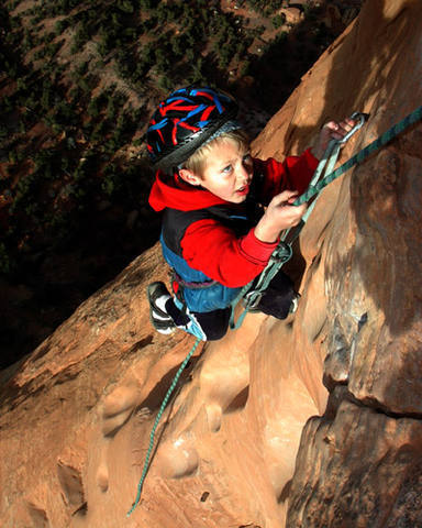You think you're tough. Here's Zane, age 5 or 6, finishing up the final overhang (with a little aid).