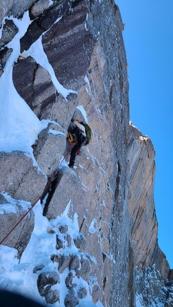 The first pitch: after the step from the snowfield. Sloped rock, few pick holds, super fun.
