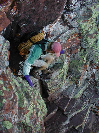Kelly down climbs a colorful dihedral typical of the scrambling on the route.