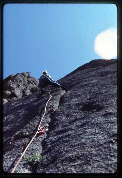 "This picture was taken on the first ascent in June '81. Note the Levi's and no harness, just the 2"" swami. Footwear by EB....<br> Photo: Bill Wylie"