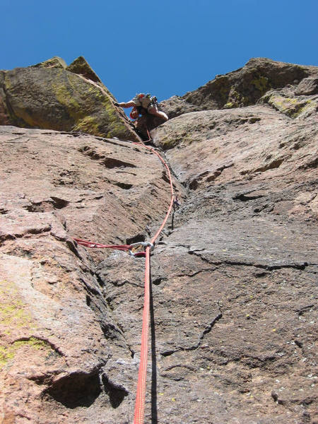 Mike looks down from the crux overhung section of pitch 2.