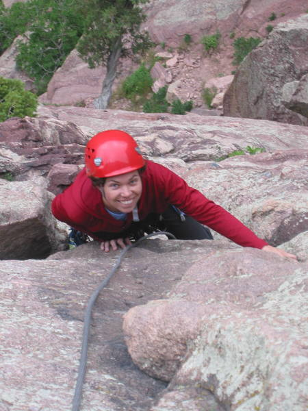 Erin Koenig all smiles as she approaches the top of pitch 1 on Boulder Direct.