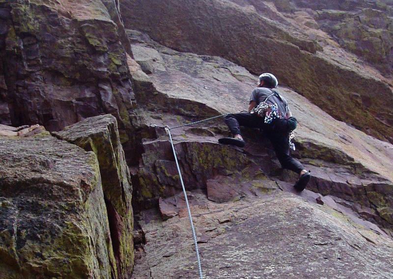 John Courtney on the 10d crux at the 2nd bolt.