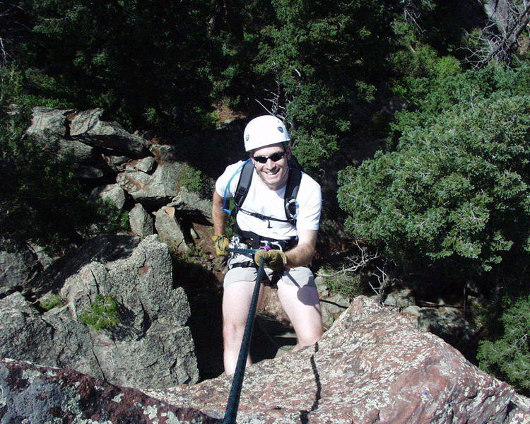 """""""RAPPEL 75 FT NORTH.""""  A very white man going off the summit."""