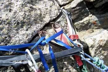 Here's a pic of anchors on top of Sharkstooth. Three old pins backed up with a chockstone. The rap station is on N.E. side of the summit.