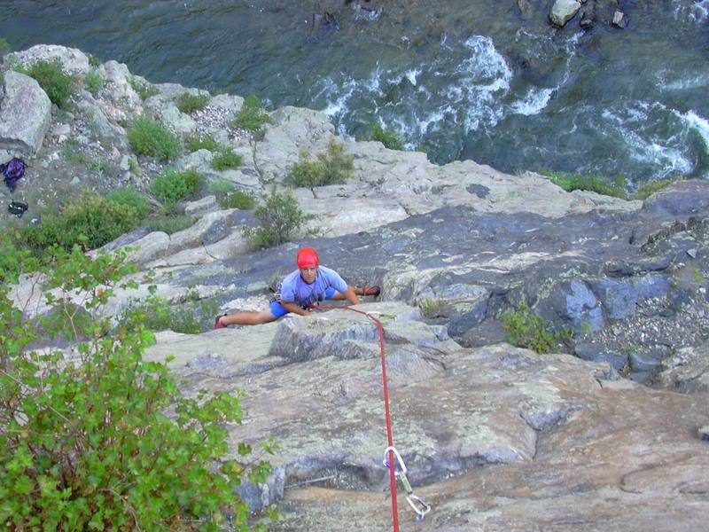 Hill stemming the crux of pitch 1.