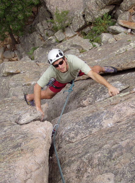 Peter Dillon nearing the airy belay pedestal at the end of the first pitch.