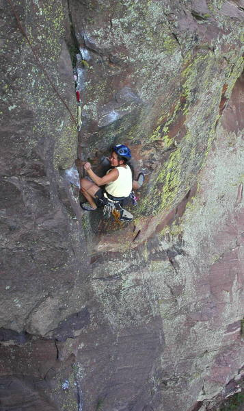 Yvonne D'Andrea cranking the crux on the first pitch.  The fun isn't over until she can reach the #1 Camalot above her.
