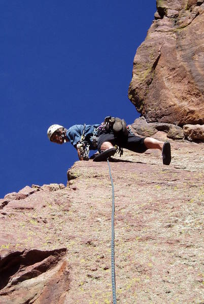 At the bolt on the slab on pitch 2. Looking down at Jules Verne.<br> Photo by Paul Rezucha.
