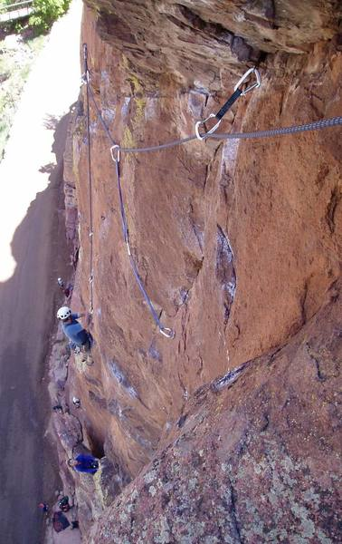 Looking down the crux pitch on a typical busy Bastille day. The chalk everywhere indicates the various options. I climbed the crack to the high pin, then down right to the bolt (with the two long slings), then back up to the belay.