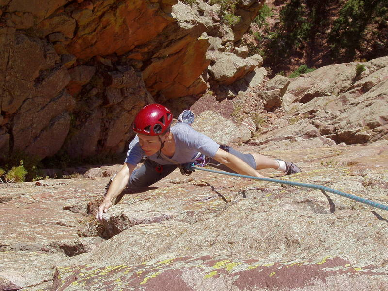 Christa Cline on the crux traverse at the end of the third pitch.