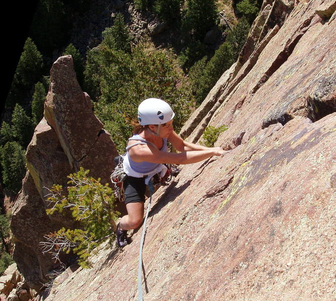 Marga Powell jamming the final crack to the summit.  Rebuffat's Arete looms in the background.