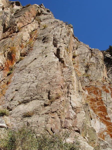The first pitch follows corners and cracks left of the blunt buttress in the right-center of the photo.