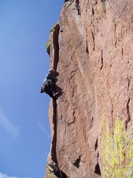 Chuck Graves at the 10c crux. A few more feet and you can get inside, and it eases to 5.9.