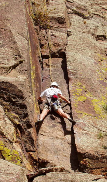 Janet Conner stemming the crux slot on the first pitch.