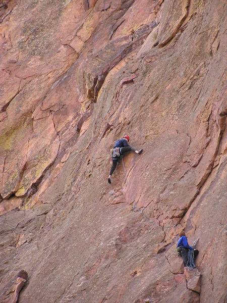 At the mantel after the crux reach on the std 3rd pitch...