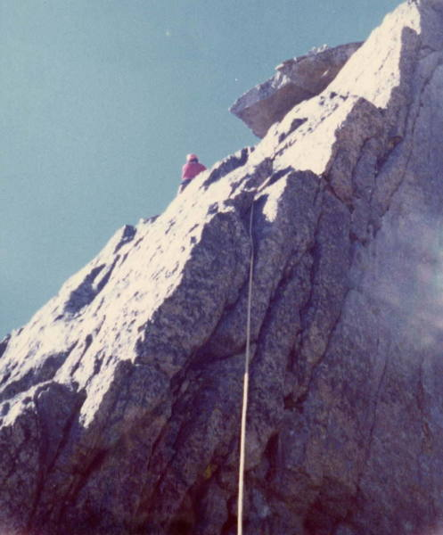 Gary Cale leading up the left side of the last tower along the Keyhole Ridge, the second to last pitch of the climb.
