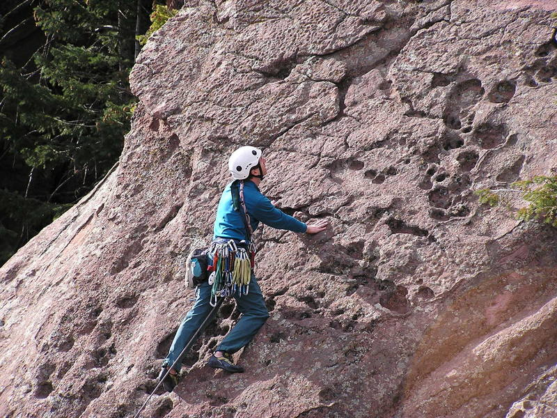 Tim is checking out the cool rock on the east ridge of Yodelings moves.