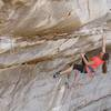 Alex Ritchie on the upper section of Pod before the final showdown boulder problem.