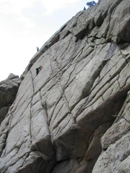 Manda watches the crack peter out as another climber that just finished the Cozyhang dihedral contemplates suicide.