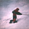 """""""T minus 1 year and counting""""  Feb, 1968 Reed Markley chops steps in Odell's about 1 year before Chouinard would introduce his drooped pick axe. Note the long axe. In 1968 an ascent of Odell's would take most of the day!   (photo from super-8 movie film)"""