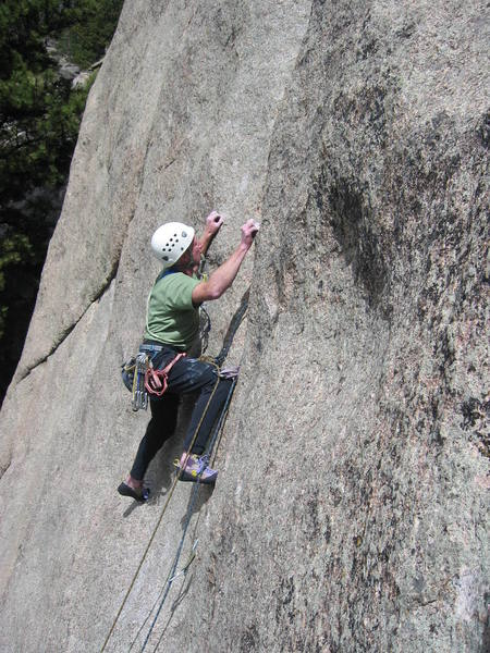 Working on the gear at the crux.