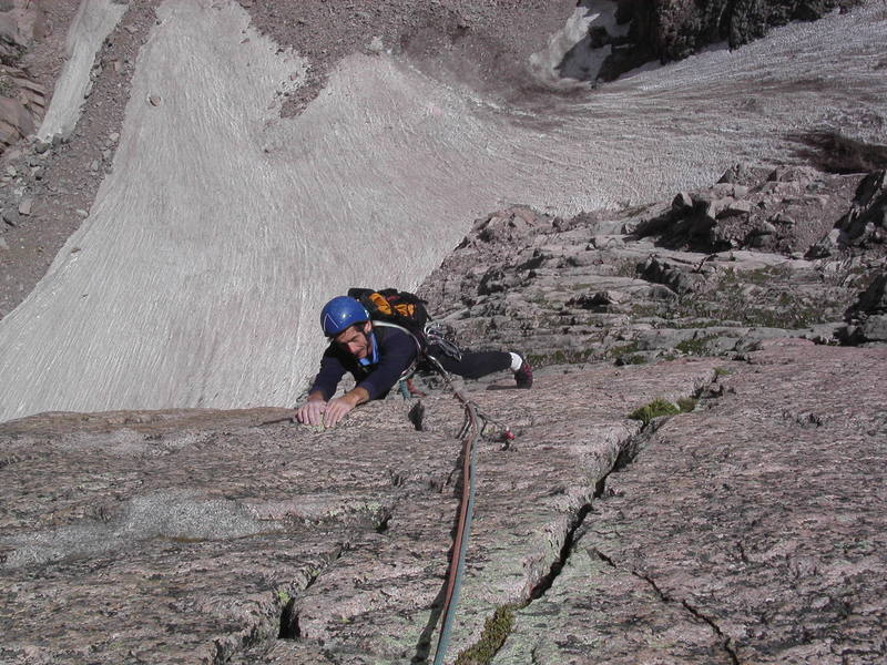 Mike Amato nearing the top of the second pitch, with Lambs Slide and Mills Glacier below.