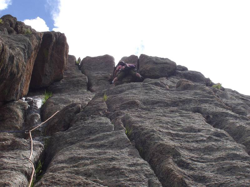 Christa is about to pull the crux on pitch 3.