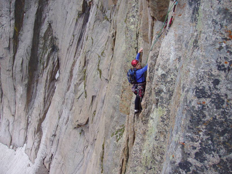 Approaching the crux undercling on pitch 4.