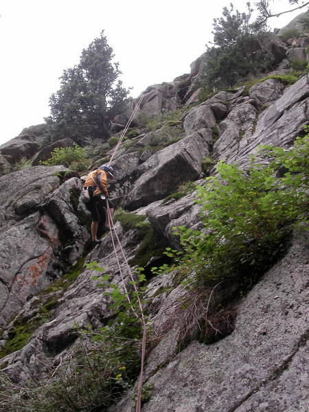 Yvonne D'Andrea rappelling to the big terrace below Lost Highway.  From the rappel, walk about 100' right to get to the start of the route.