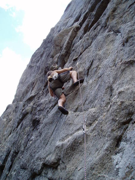 """Above the crux on the popular 10a """"first pitch""""."""
