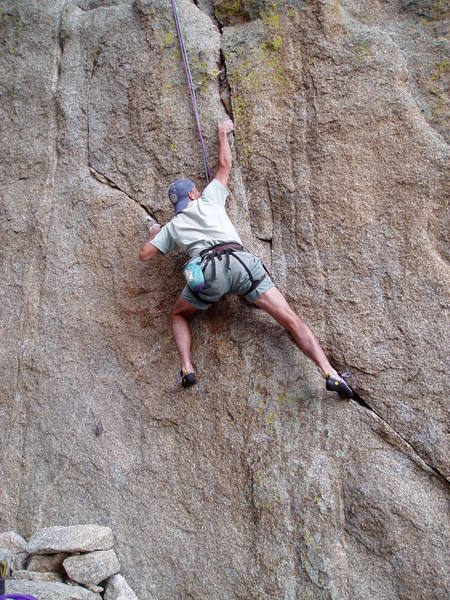 A perhaps unusual way to do the crux with the right foot way down and right jammed in the crack.